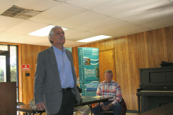 Richard Lowerre introduces the event, with a Ramsar banner in the background