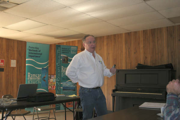 A attorney gives a presentation on oil and gas trends in the Caddo Lake area.